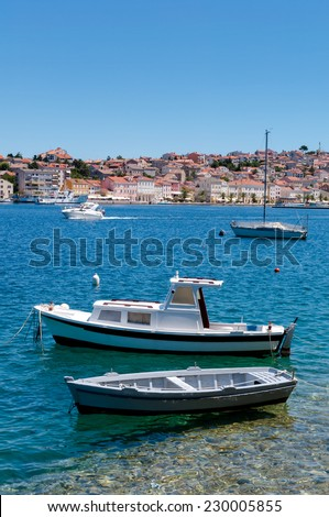 Boats docked on little beach in Mali Losinj - Croatia Vertical - stock photo