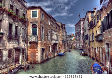 Boats & Gondola down a street canal off the Grand Canal in Venice, Italy - stock photo