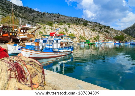 Boats in a port in one of Greek's islands - stock photo