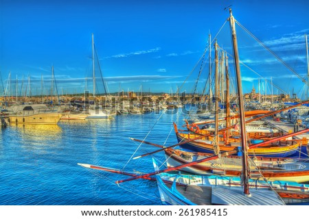 boats in Alghero harbor at sunset. Processed for hdr tone mapping effect - stock photo