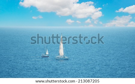 boats in Alghero sea on a cloudy day - stock photo