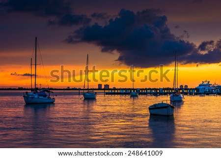 Boats in Biscayne Bay at sunset, seen from Miami Beach, Florida. - stock photo