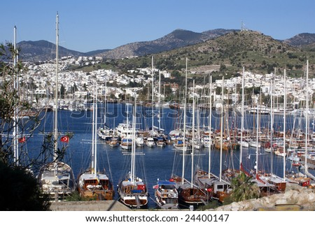 Boats in Bodrum marina and mountain, Turkey - stock photo