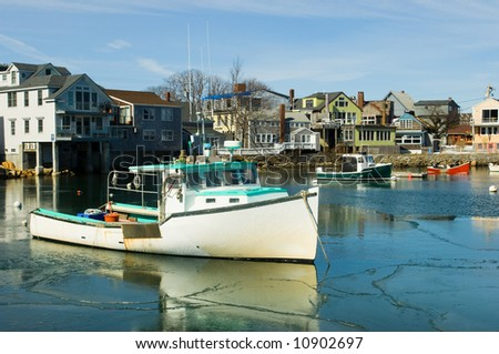 Boats in fishermen village of Rockport on Atlantic coast of Massachussets - stock photo