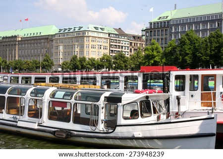 Boats in front and beautiful view of  Hamburger with harbor, Hamburg, Germany - stock photo