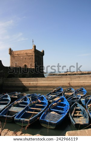 Boats in front of ramparts - stock photo