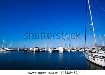 boats in harbor. Boats bow in marina - stock photo