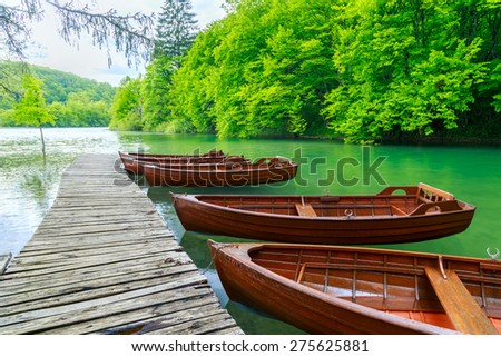 Boats in Plitvice lakes and pier, Croatia. Plitvice national park - stock photo