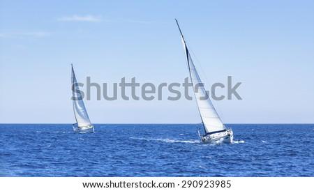 Boats in sailing regatta. Sailing yacht race. - stock photo