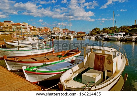 boats in Stintino small harbor with oil painting effect - stock photo