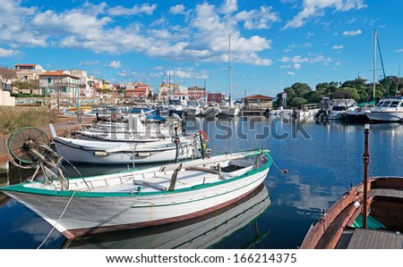 boats in Stintino small port on a sunny day - stock photo