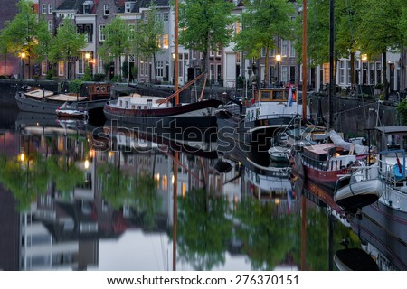 Boats in the harbor in the evening in the city center of den bosch, capital of province noord-brabant, in the old historical and characteristic town, netherlands, europe - stock photo