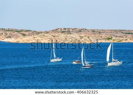 Boats in the rocky archipelago - stock photo
