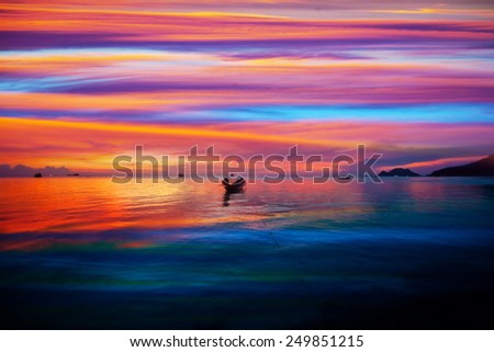 Boats in the sea and the sunset sky - stock photo