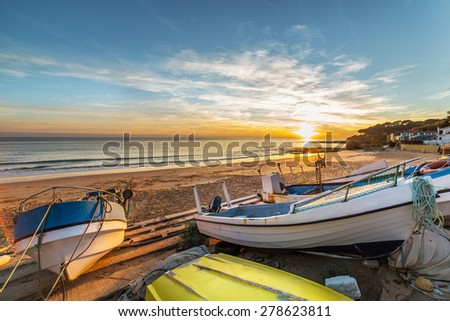 Boats in warm sunset light on the Fisherman's Beach (Praia dos Pescadores) in Albufeira, Portugal - stock photo