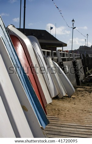 Boats lined up in the morning sun Broadstairs - stock photo