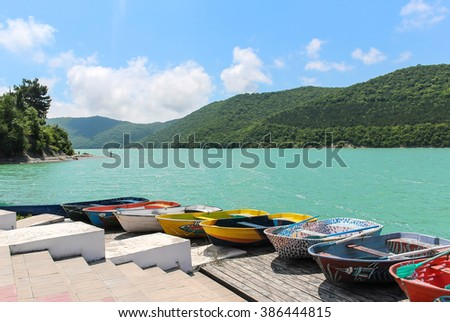 Boats. Many colorful fishing boats docked to coast. Landscape & boats. Beautiful boats.  Boats & hills. Colored boats. Handmade boats. Boats & water. Boats & sky. Boats & forest. Best boats. Russia. - stock photo