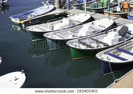 Boats moored at a marine dock, detail of recreational boats on a dock, fishing and fun, sea transport