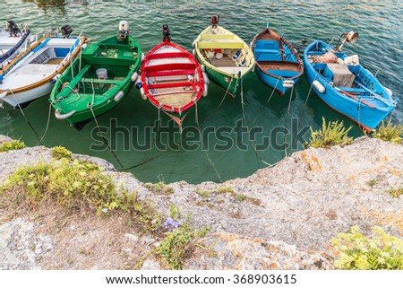 boats moored in a cove on the coast of Salento, on the Adriatic Sea in Italy