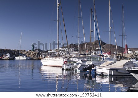 boats moored in san jose arbour, cabo de gata, spain