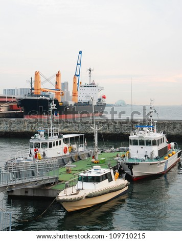 Boats moored in the port at Osaka harbour Japan