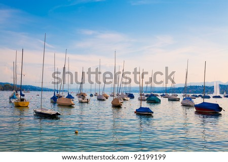 Boats moored on Lake Zurich, Switzerland - stock photo