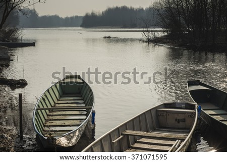 Boats moored on the river