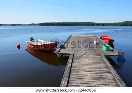 Boats moored to wooden platform on Chancza lake