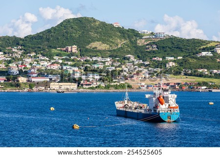 Boats off the beautiful coast of St Kitts - stock photo
