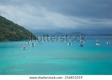 Boats off the coast of Jost Van Dyke in the British Virgin Islands before a coming storm. - stock photo