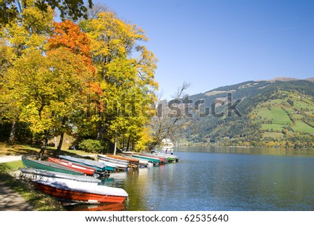 """Boats on a beautiful autumn day in """"Zell am See"""", Austria. - stock photo"""