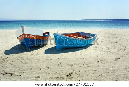 Boats on a secluded beach in Paternoster, South Africa - stock photo