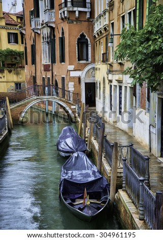 Boats on a Side Canal in Venice, Italy in the Rain - stock photo