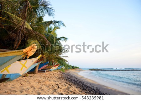 Boats on a tropical beach at sunset, Mirissa, Sri Lanka