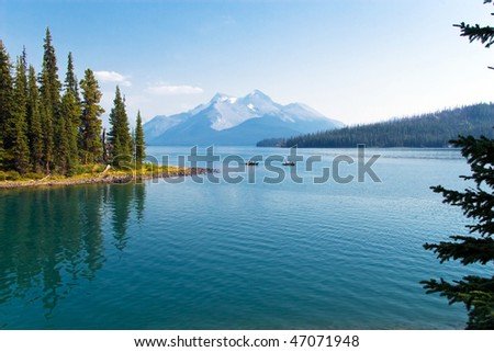 Boats on beautiful mountain lake with peak view