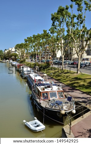 Boats  on canal of the Robine (canal de la Robine) at Narbonne, town located in the Aude department and the region Languedoc-Roussillon in the south of France