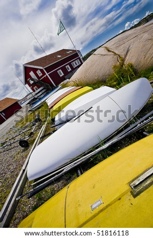 Boats on land in the swedish countryside. - stock photo