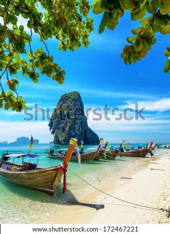Boats on Phra Nang beach, Thailand. - stock photo