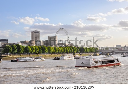 Boats on River Thames in London, United Kingdom - stock photo