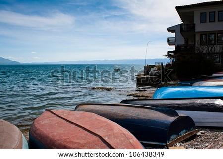 Boats on the coastline of lake Ohrid in Macedonia - stock photo