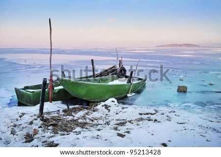 Boats on the frozen lake - stock photo