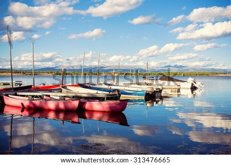 Boats on the lake at sunset in Colter bay - stock photo