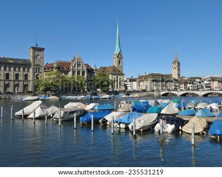 Boats on the Limmat and Fraumuenster, scene in Zurich - stock photo