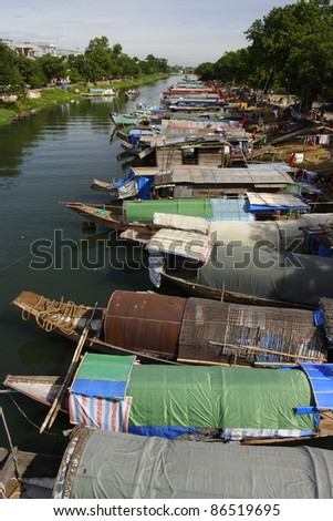 Boats on the perfume river in Hue in Central Vietnam South East Asia