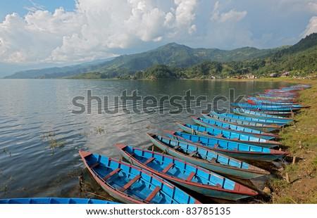Boats on the Phewa lake . Pokhara - stock photo