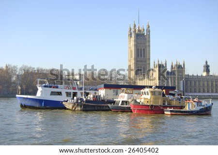 Boats on the River Thames in front of Victoria Tower in London, England - stock photo