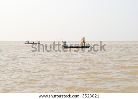 boats on the Tonle Sap lake, Cambodia - stock photo