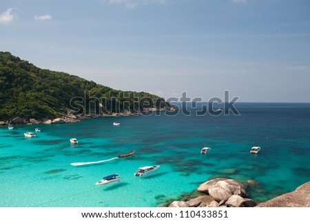 Boats on the water at the Similan Islands - stock photo