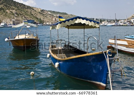 Boats on water in resort town. Recorded in place Balaklava in region Crimea on Black sea.