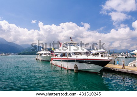 boats parking at the pier in sun moon lake in taiwan